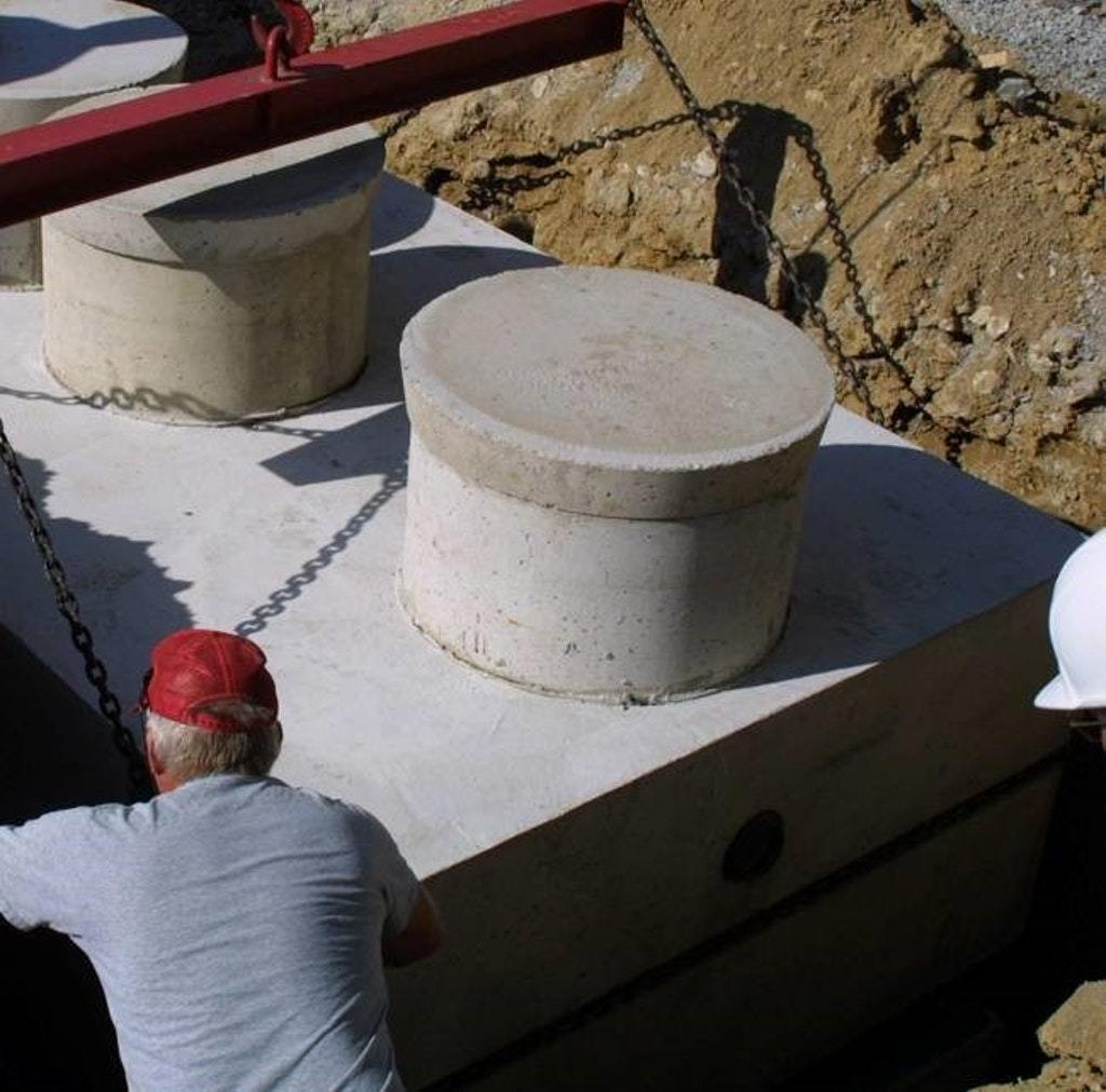 A concrete riser using a cold joint.